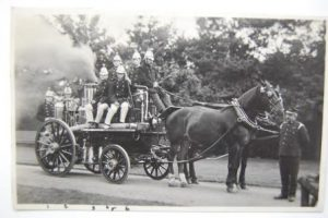 Photograph of Bootham School Fire Brigade 1911, students in fire brigade uniform with horsedrawn fire engine.
