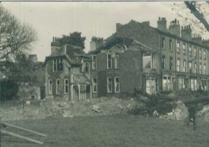 Photograph of the old Lodge (on Portland Street) after the bombing raid in 1942.