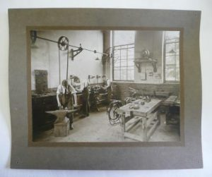 A photograph of the metal workshop, from the 1919 prospectus.
